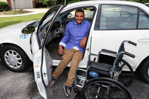 Client transfers to car from wheelchair